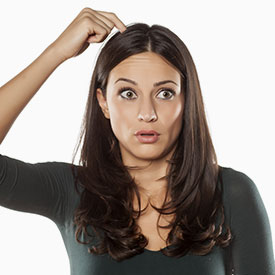 worried mom scratching her head because of head lice