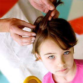 girl getting checked for head lice